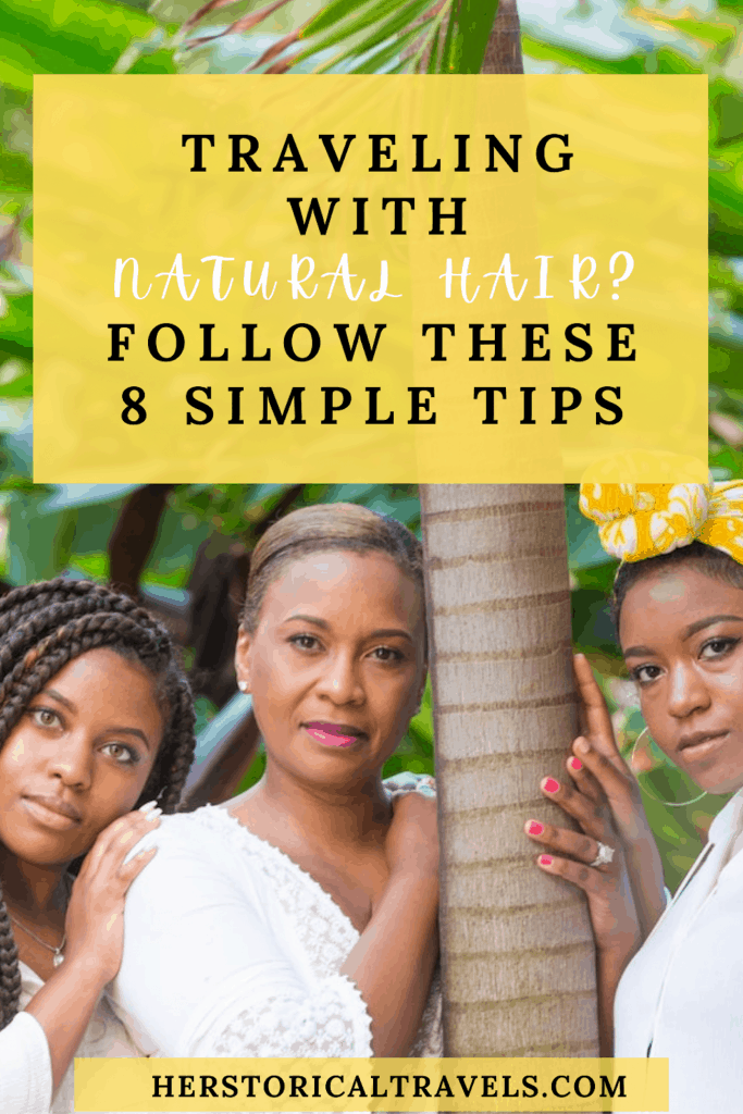 Three black women with their hair in different hairstyles. One is wearing box braids, the second is wearing straight hair, and the third is wearing a yellow head wrap. They are posing in the cayman islands, in a rain forest while wearing white dresses